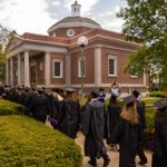 Graduates walking by Kirk Memorial