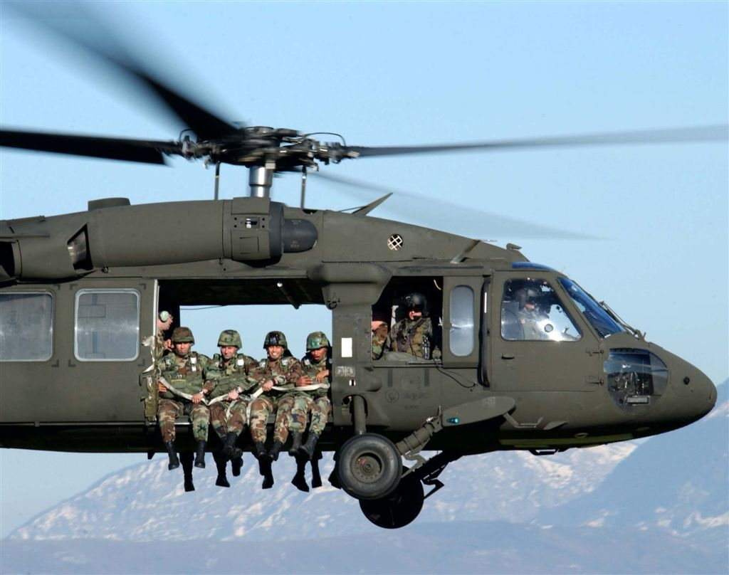 soldiers in a helicopter