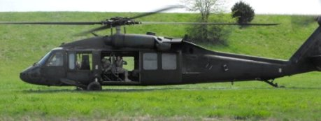 Helicopter landing in a field