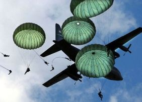 paratroopers jumping from a C130