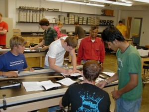 students working in a physics lab