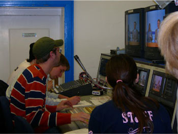 Students working in a newsroom