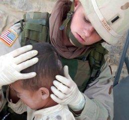Nurse Examining Child