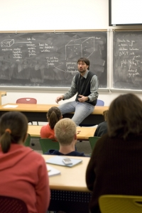 Dr. Edis lectures a physics class