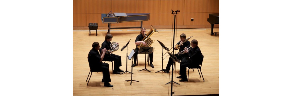 A performance of one of the Truman brass quintets