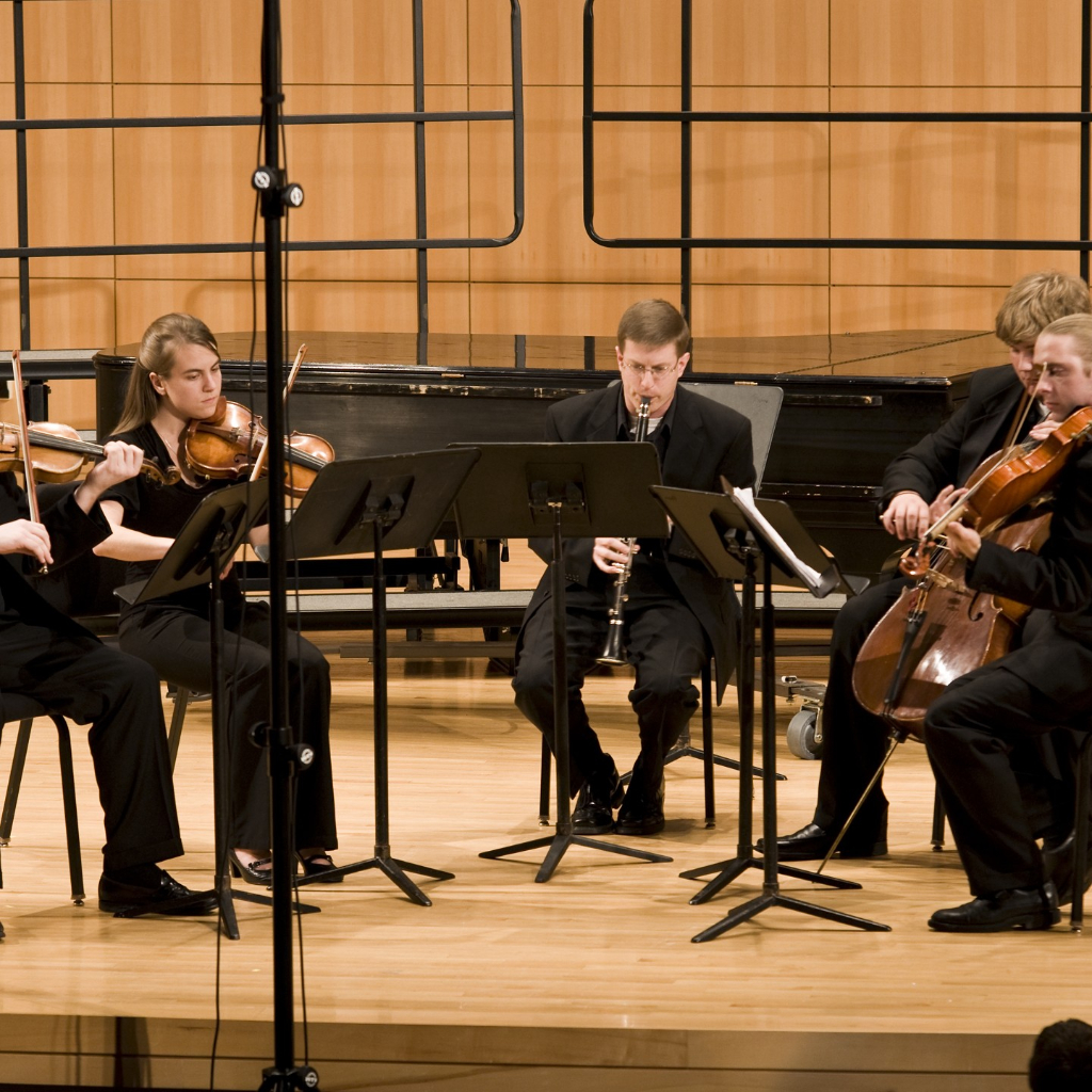 Dr. Krebs performing Miniatures by Vivian Fung with the President's String Quartet