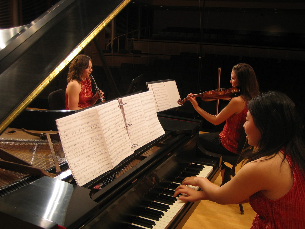 Erin Miesner performing a chamber music recital with the Eclectic Accord Piano Trio.