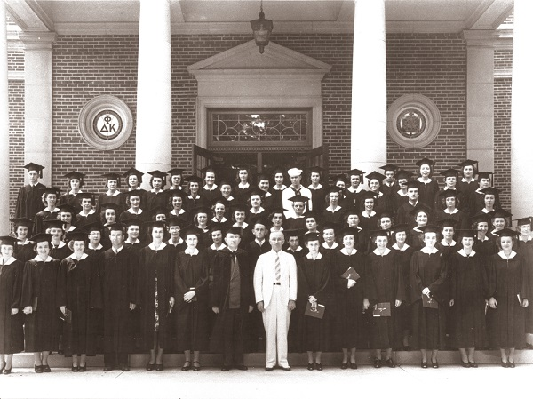 It's easy to spot Harry S. Truman front and center posing for this photo with the Class of 1943 standing on the steps in front of Kirk Memorial on the campus of Truman State University.