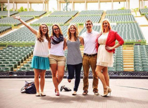 John along with friends at the Muny