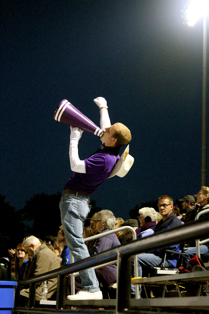 Member of the Statesmen Marching Band cheering for the football team