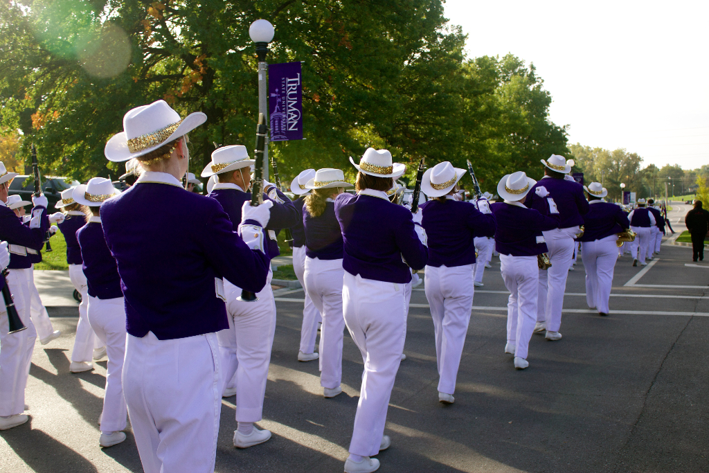 The Statesmen marching band marching in the Homecoming Parade