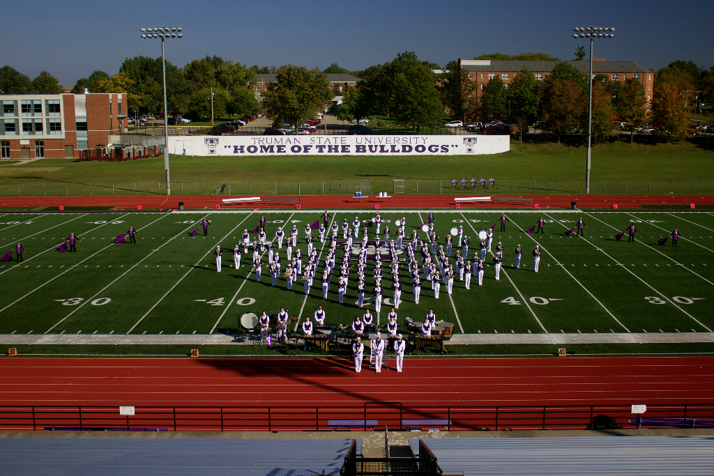 Statesmen Marching Band performing on Truman's football field