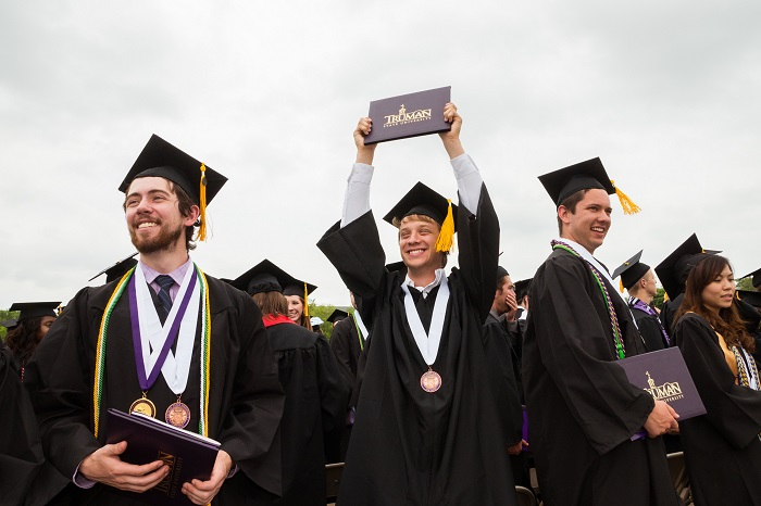 Spring 2015 Commencement - Holding up Diploma