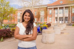Thilini standing in front of Violette Hall on the Truman State University campus