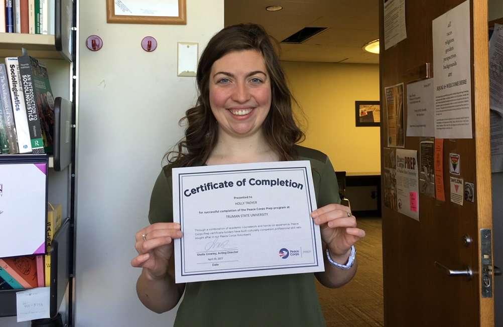 Holly Troyer with her Certificate of Completion for the Peace Corps Prep Program