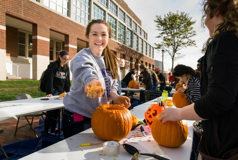 Pumpkin carving on the campus mall
