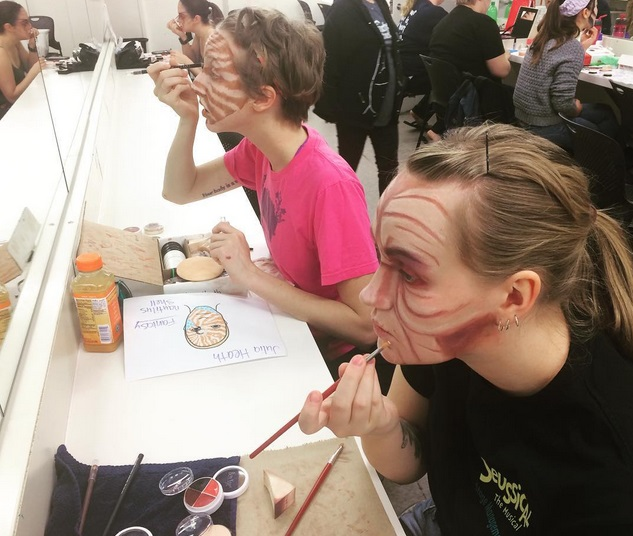 Students applying stage make-up