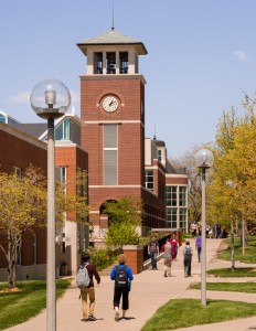 Students walking to class by Clock Tower and Library