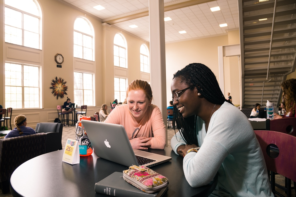 Students studying in the Hub in the Student Union Building