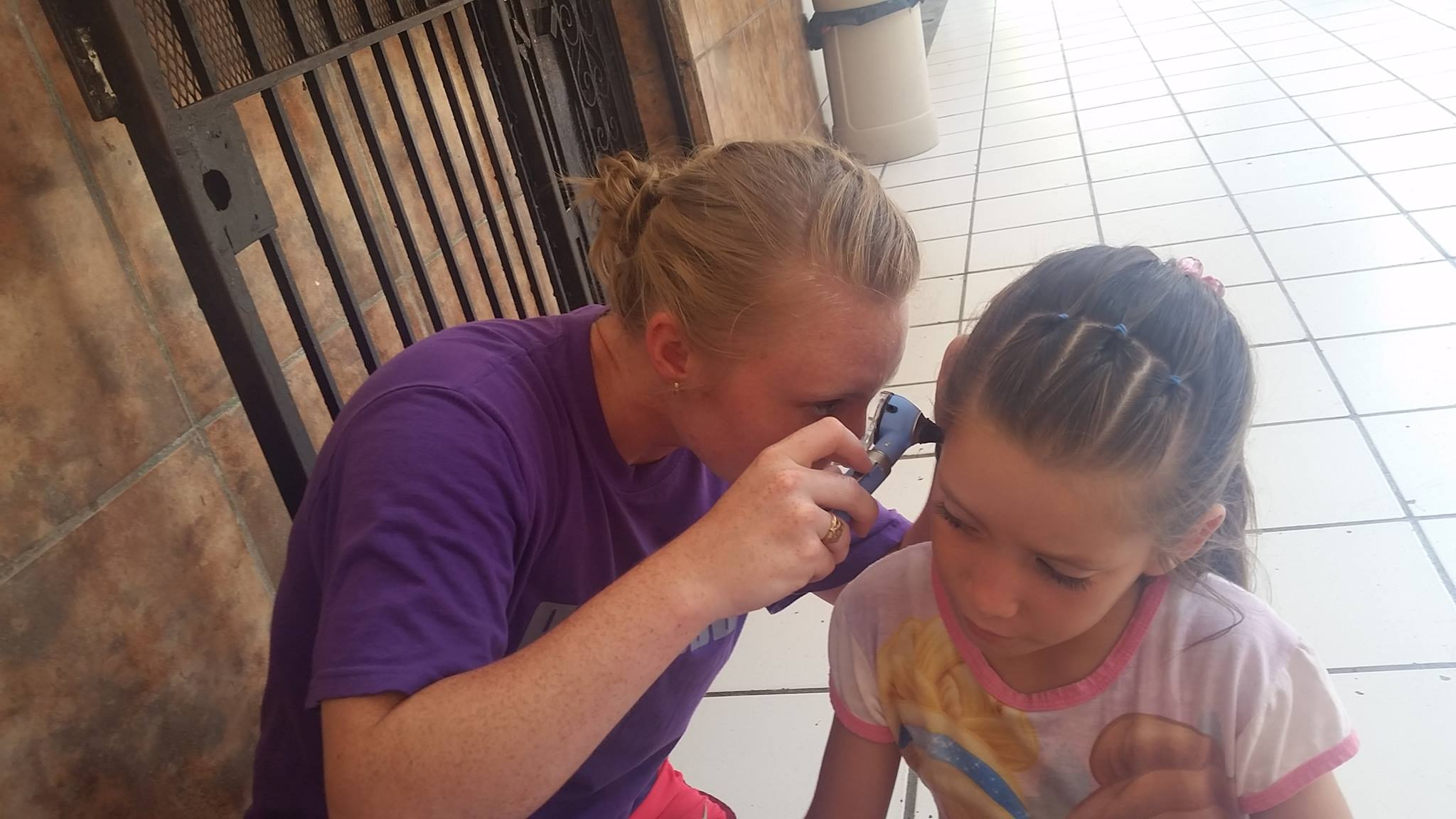 Mackenzie uses otoscope