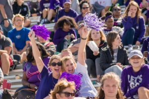 Bulldog fans cheering at a football game in Stokes Stadium