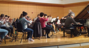 University Orchestra collaborating with members of the Boccherini and Puccini Conservatories
