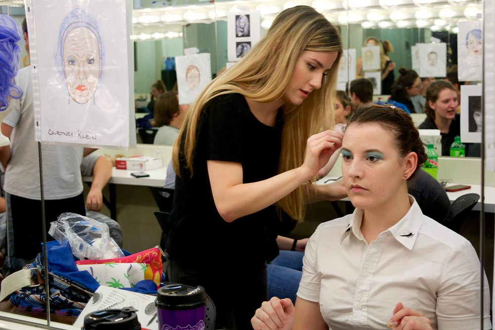 Working on hair and make-up in preparation for a theatre production