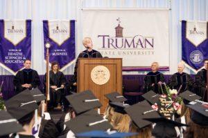 President Thomas addressing graduates at Commencement