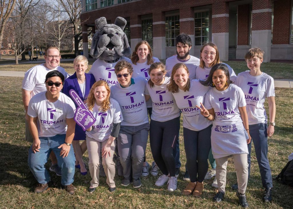President Sue Thomas with a group of students and the Spike, the Truman mascot