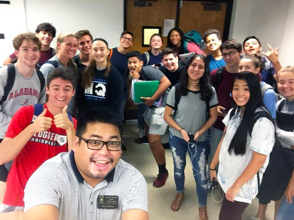Teacher taking selfie with students