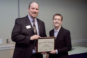 Deb Kerby presented award to Michael Barnes