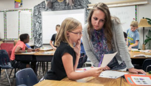 Teacher working with a student in the classroom