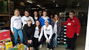 Group of volunteers helping out at Food Bank
