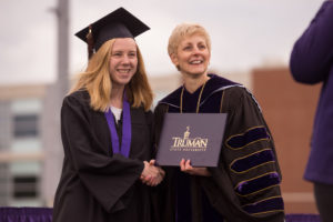 Truman student presented with diploma by President Sue Thomas