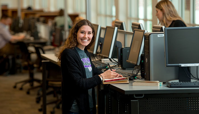 Student using a computer in Pickler Memorial Library