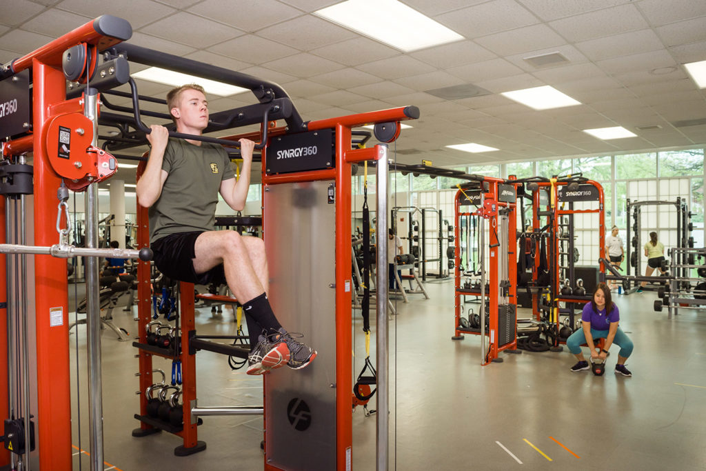Students working out in weight room