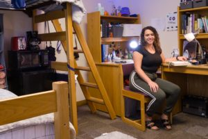 Residence hall room with student and microfridge