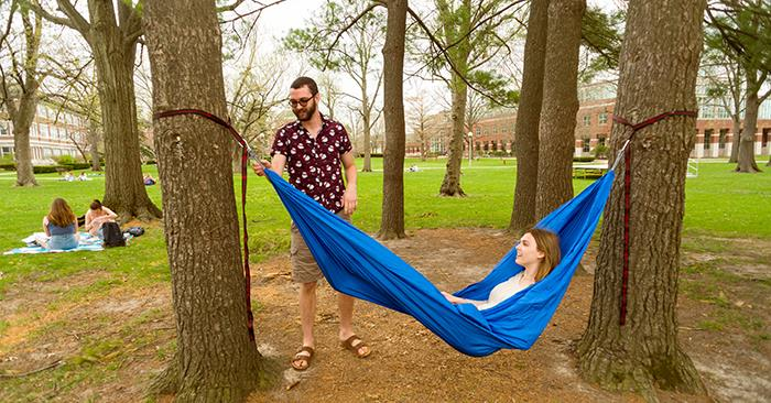 Students and a hammock on the Quad