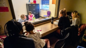 Communication disorders students working with children in speech and hearing clinic